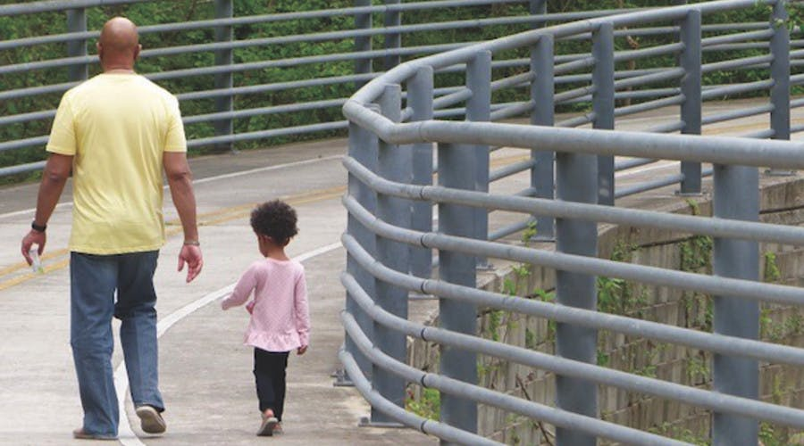 Dad and child in park